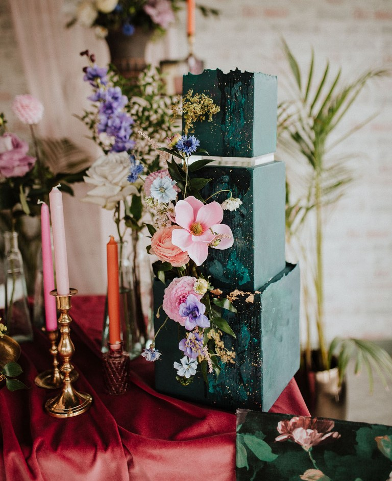 The second wedding cake was a dark green square one, with bold blooms and green brushstrokes