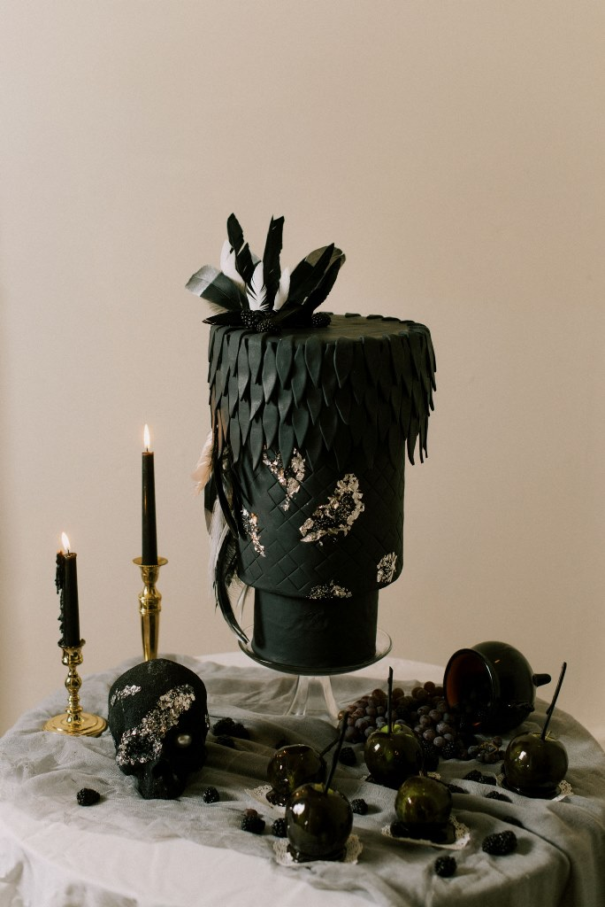 The wedding cake was an upside down one, in black and gold foil plus feathers and blackberries on top