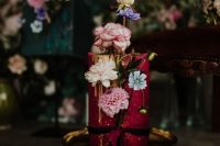 12 The third wedding cake was a burgundy one, with gold drip and pastel blooms