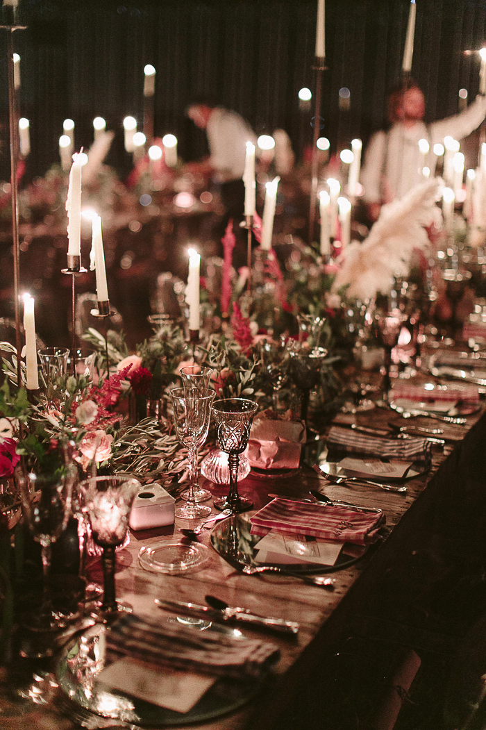 The wedding tablescape was refined, with greenery, pink blooms, plaid napkins and lots of candles