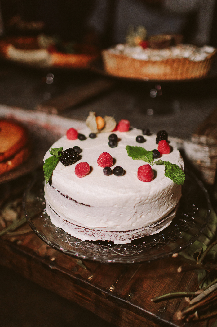 The wedding cake was a white one topped with fresh berries and mint