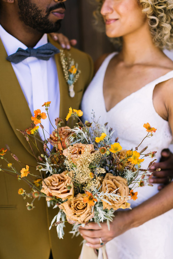 The wedding bouquet was done in yellow and rust colors, with dried and usual blooms