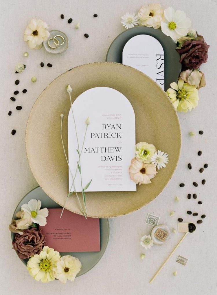 The wedding stationery was done in black, white and burgundy, with chic printing and arched touches