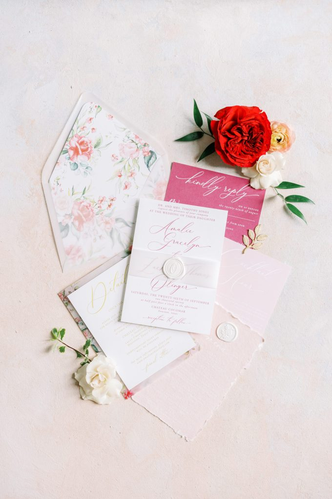 The wedding stationery was done with blush and hot pink touches and floral lining