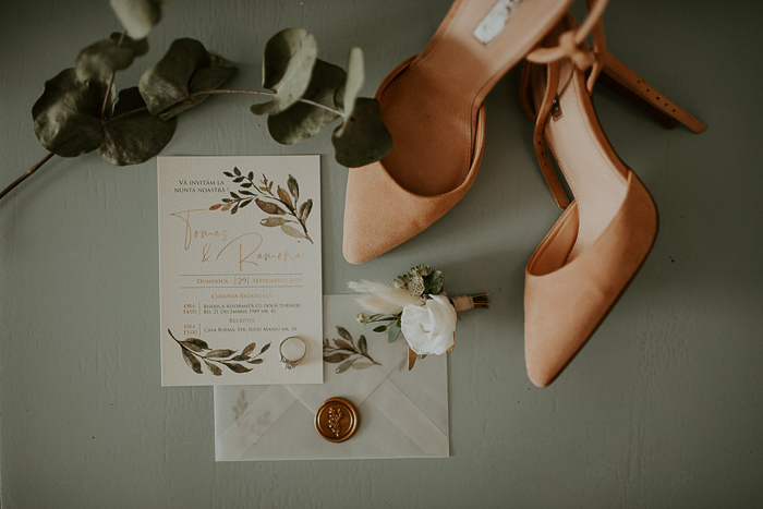 The wedding stationery was done with botanical prints and rose gold letters