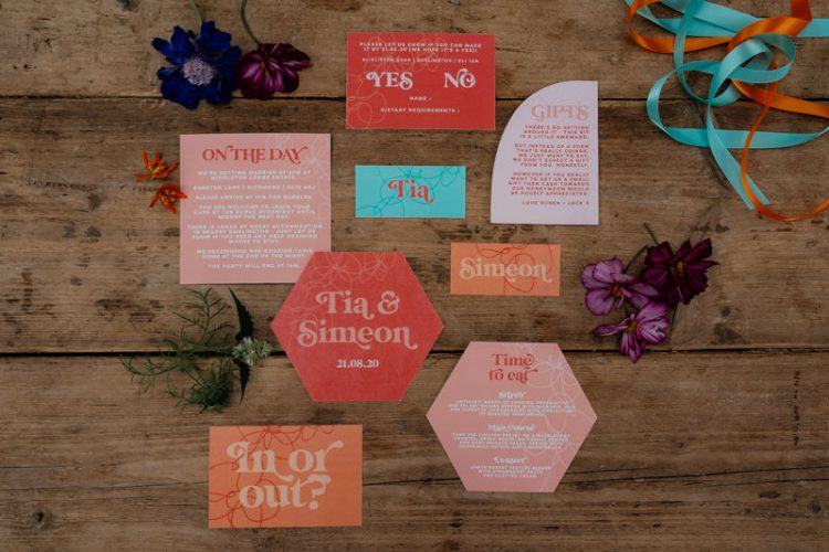 The wedding stationery was done with geometric shapes, bold colors and bright printing