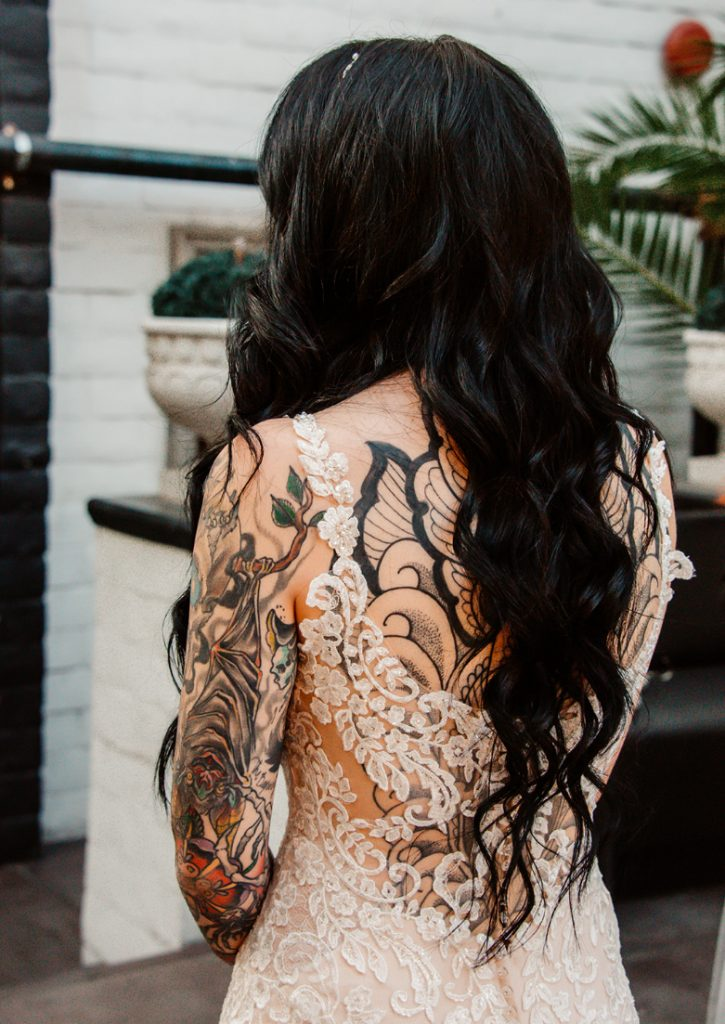 The back of the dress was opened to show off all the bridal tattoos