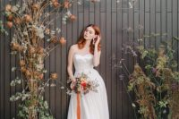 03 The bride was wearing a strapless white wedding dress with a train and statement earrings