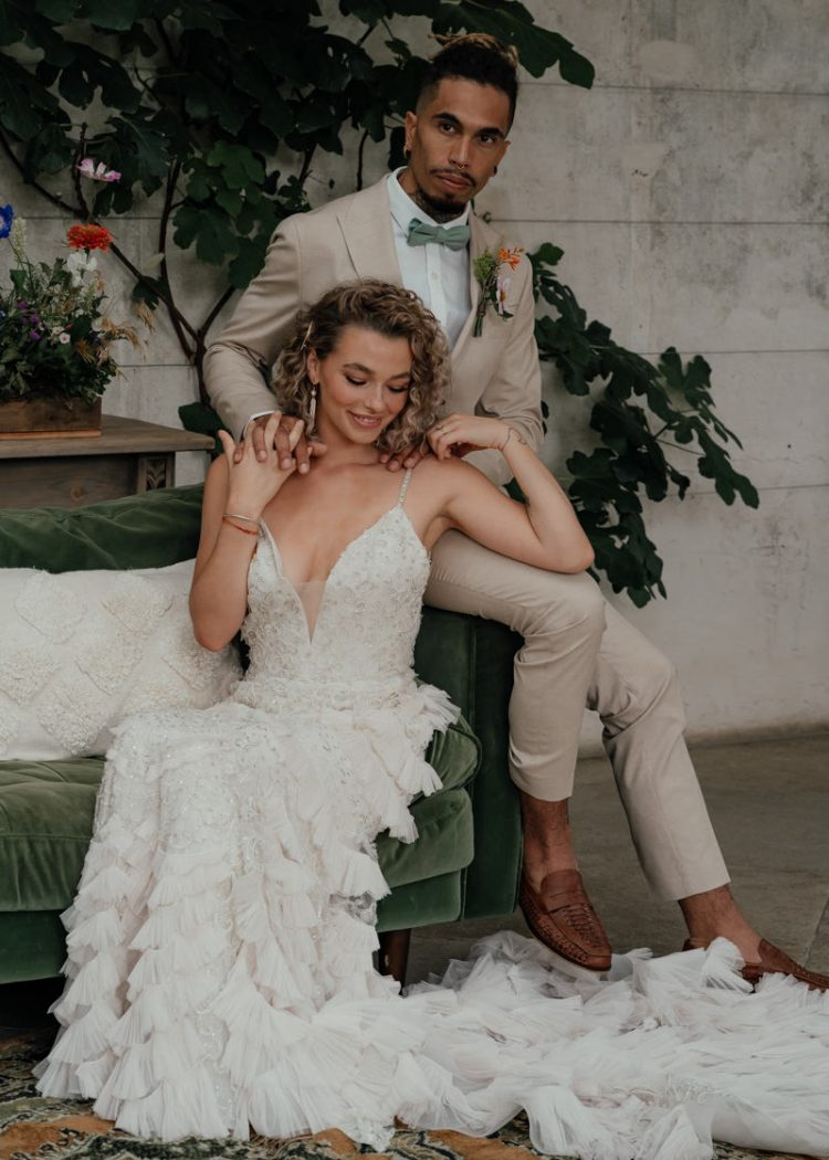 The groom was wearing a tan suit, brown moccasins and a green bow tie, the bride was rocking an embellished mermaid wedding dress with ruffles and a train