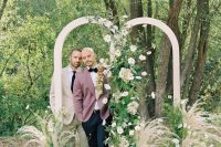 03 The wedding arch was a double one, with neutral blooms, greenery and pampas grass