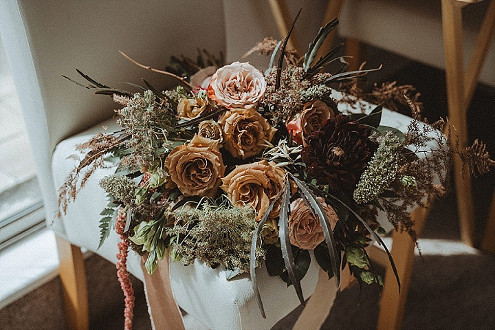 The wedding bouquet perfectly match the color scheme and greenery added texture