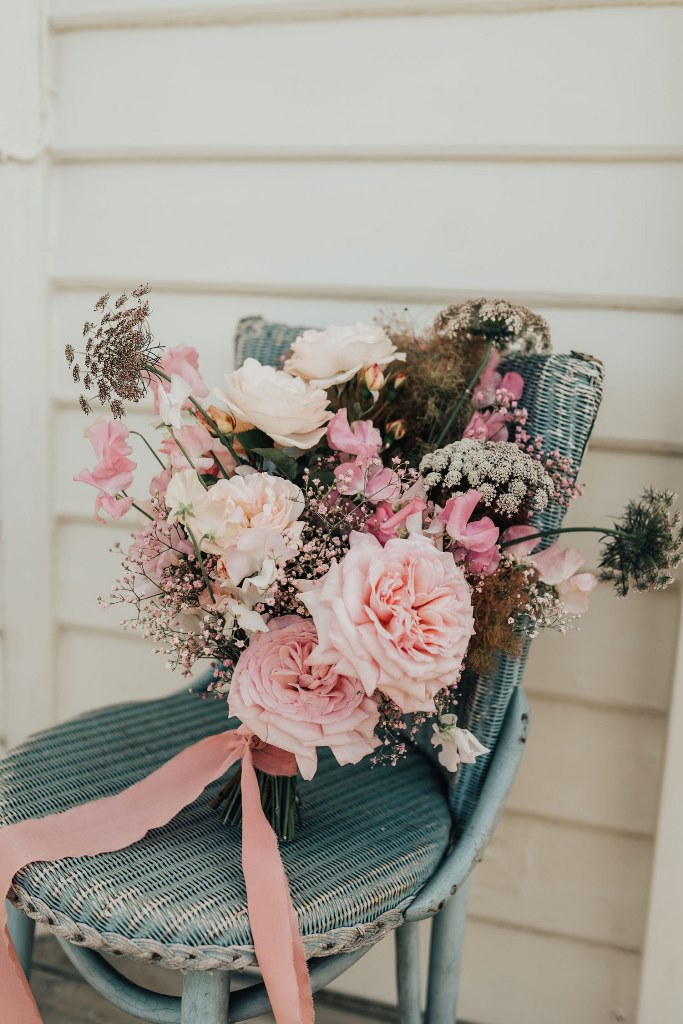 The wedding bouquet was all-pink, with bright baby's breath, roses and dried blooms, too