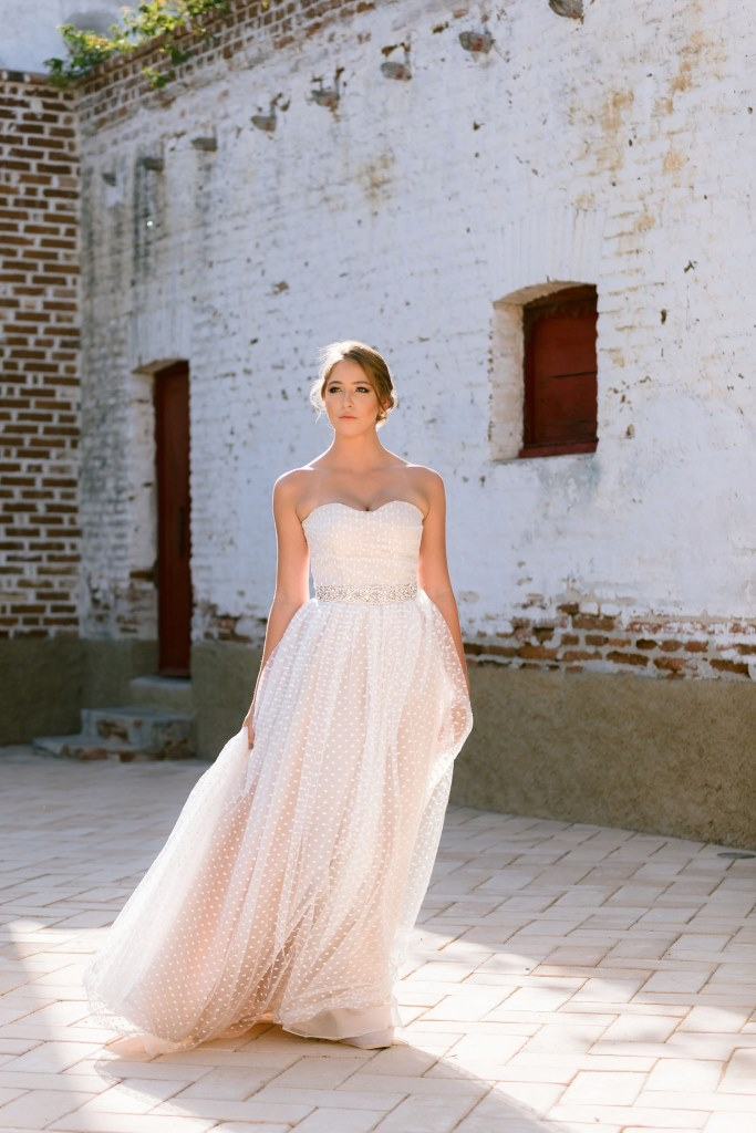 The wedding dress was a strapless polka dot one, with an embellished waist