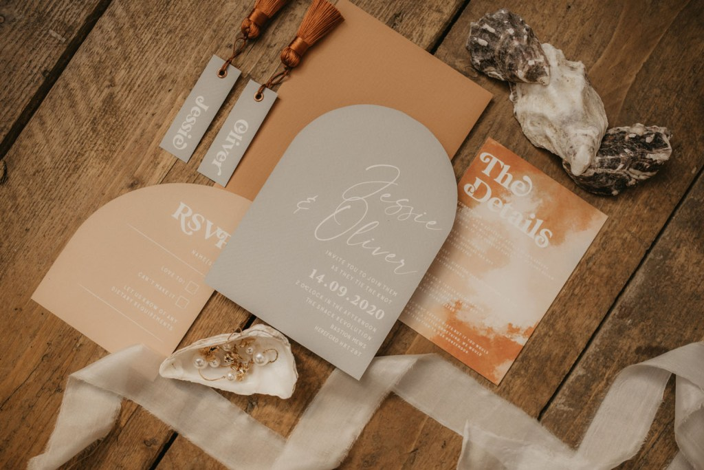 The wedding stationery was done in rust, pink and grey, with watercolor detailing