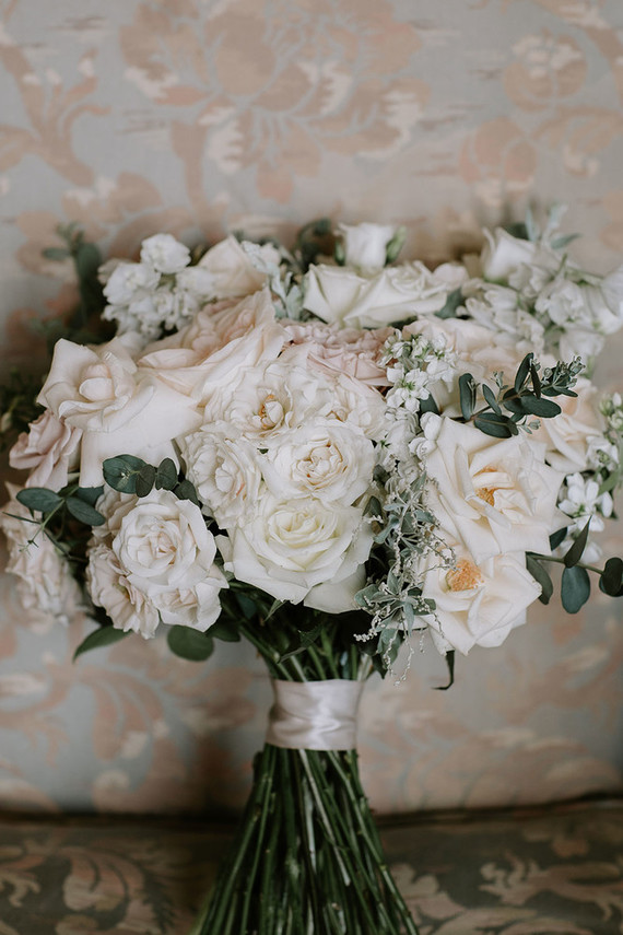 Her wedding bouquet was done with neutral and blush blooms and greenery and looked wow