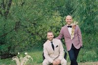 both grooms are rocking pastel suits