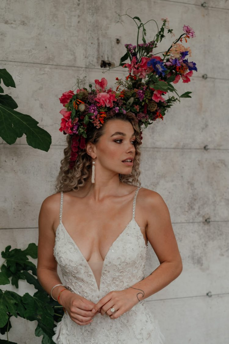 A jaw-dropping fresh flower crown was created especially for the bride to match the venue decor