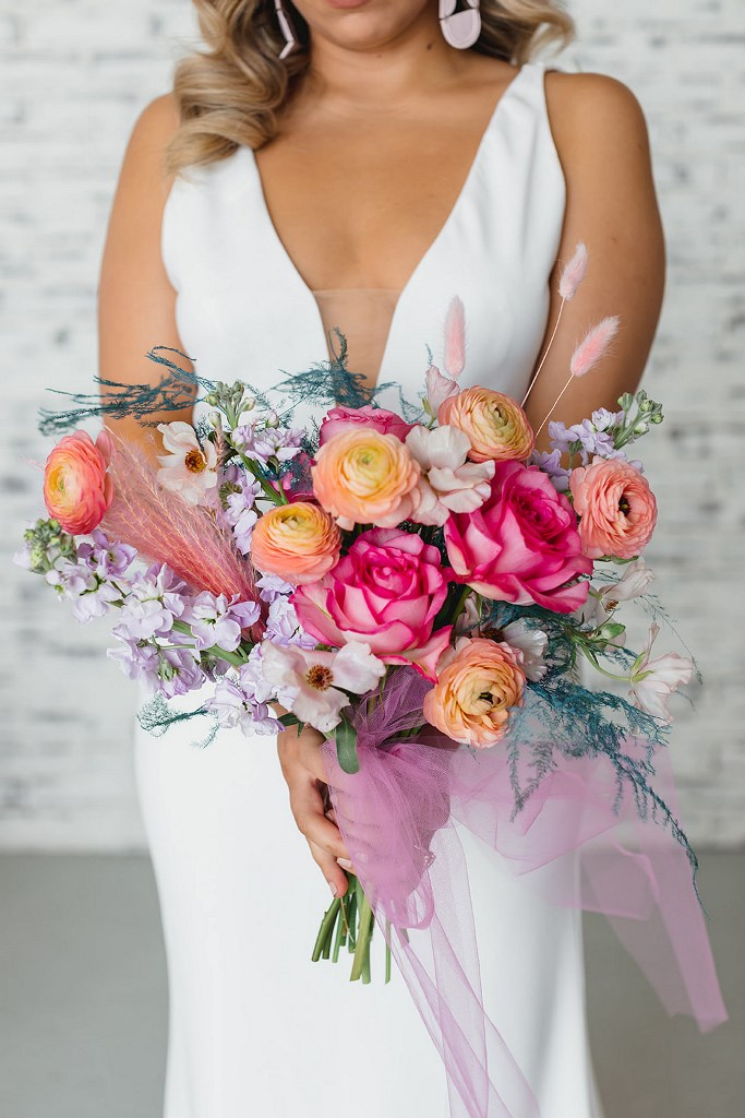 Her bouquet was super bright and bold, with sheer pink ribbons