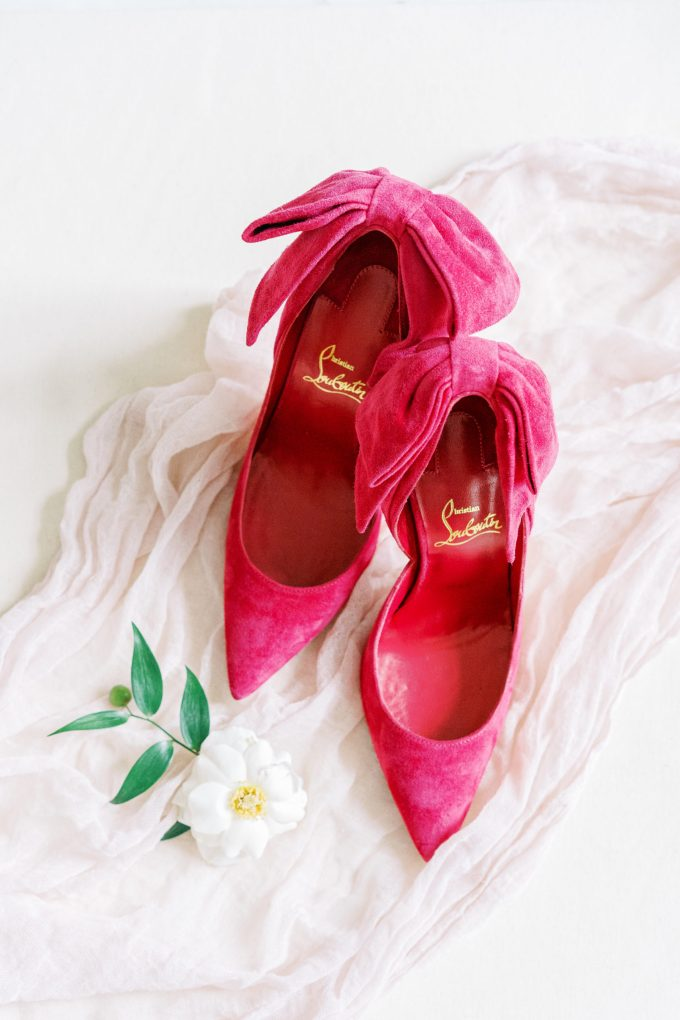 Her wedding shoes were hot pink suede ones, with large bows on the backs