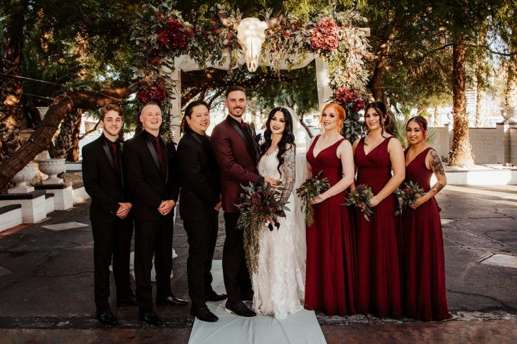 The bridesmids were wearing burgundy A-line maxi dresses and the groomsmen were rocking black tuxes and burgundy ties