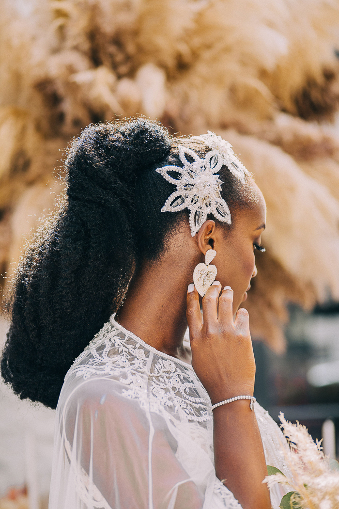The wedding headpiece was a beaded one and matching earrings added chic to the look