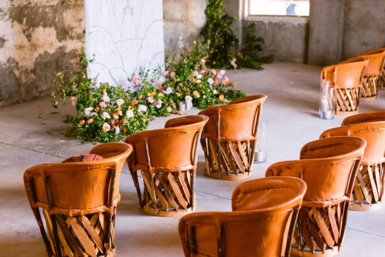 Rugged ceremony chairs that play so well with the abode structure