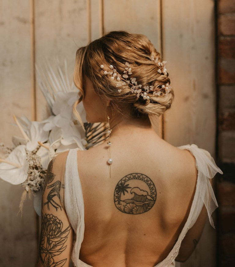 The bride was wearing a beautiful pearl and crystal headpiece to hightlight her chic updo