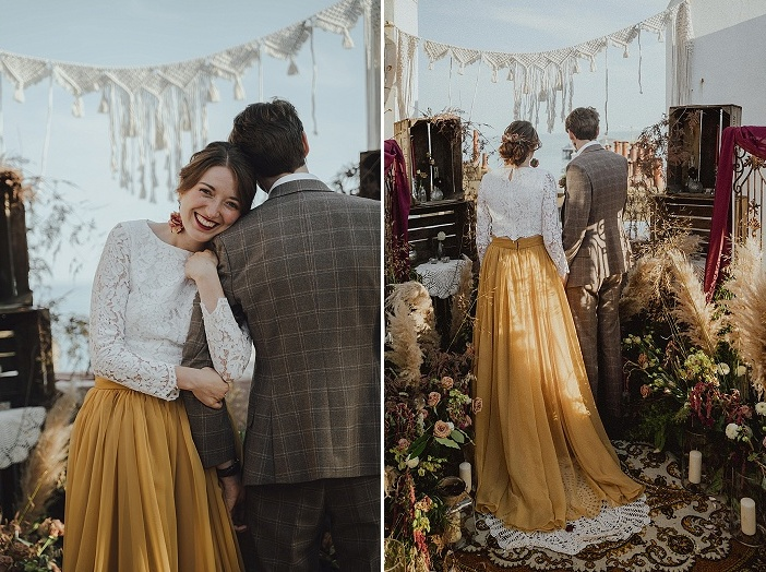 The bride was wearing a white lace crop top, a gold pleated maxi skirt with a train and fresh bloom earrings