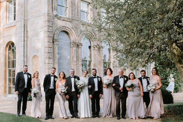 The groom and groomsmen were rocking black tuxes and the bridesmaids were wearing grey slip dresses