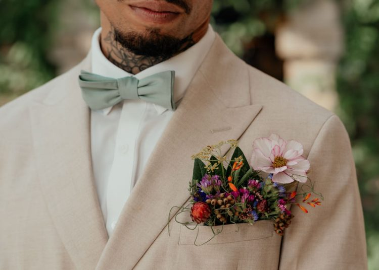 The groom was wearing a floral pocketsquare with greenery