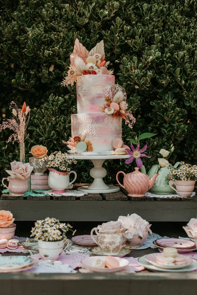 The wedding cake was a pastel-colored gradient one, with dried blooms, leaves and fronds