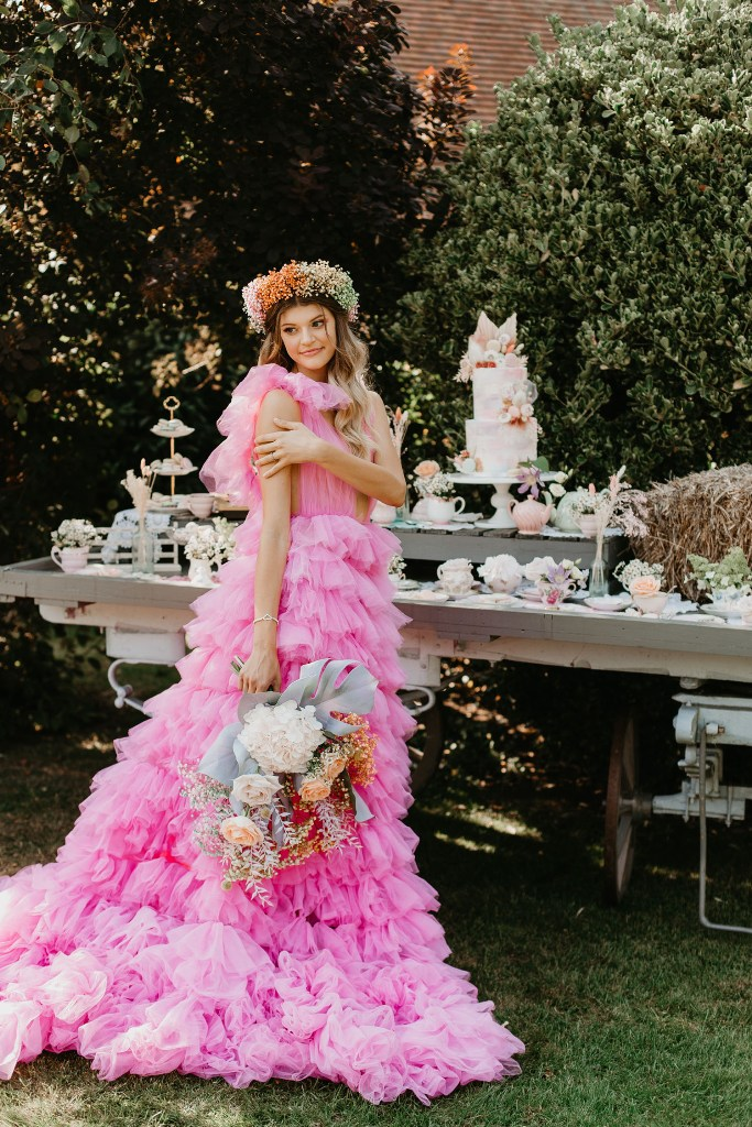 The second wedding dress was a hot pink ruffle one, with a plunging neckline and straps