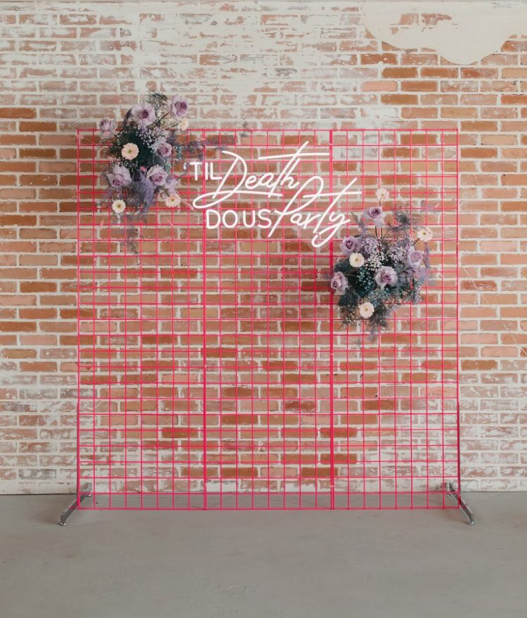 The wedding backdrop was done super bold pink, with lavender blooms and a neon sign