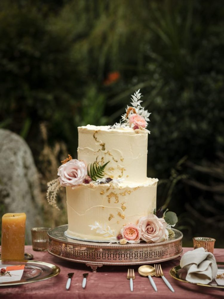 The wedding cake was textural, with gold foil and fresh pink blooms
