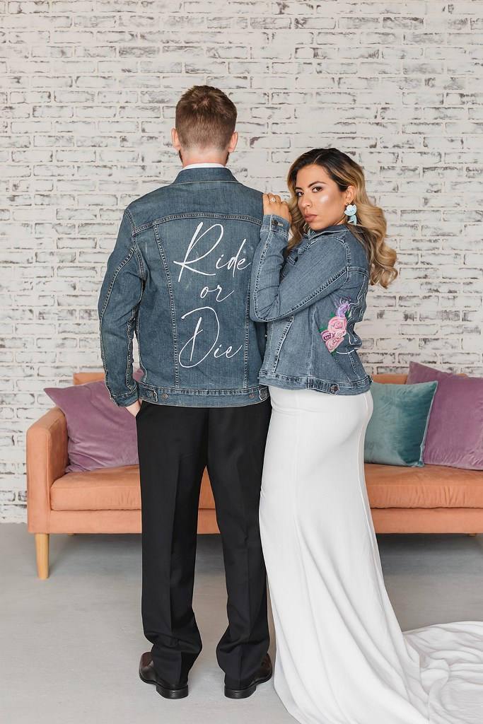 The couple covered up with denim jackets that were personalized for them
