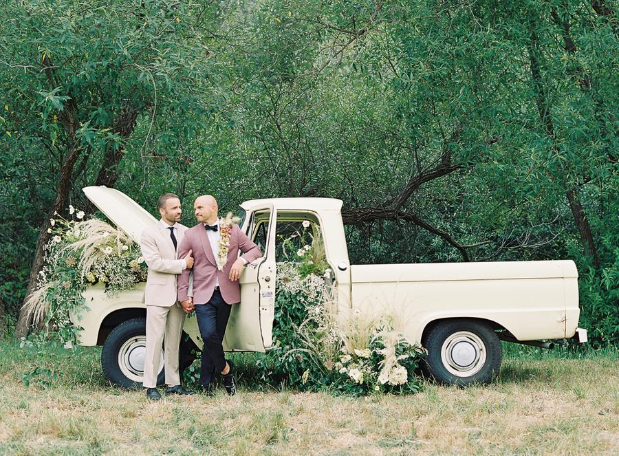 The grooms went for wedding portraits right at the truck