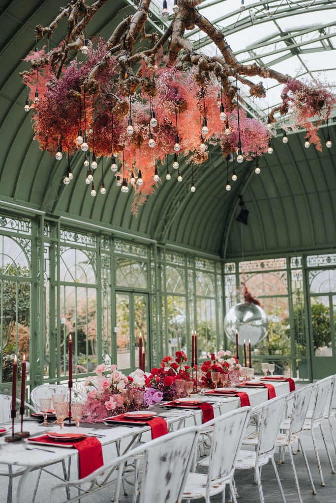 The reception space showed off a jaw-dropping branch installation with pink blooms and hanging bulbs