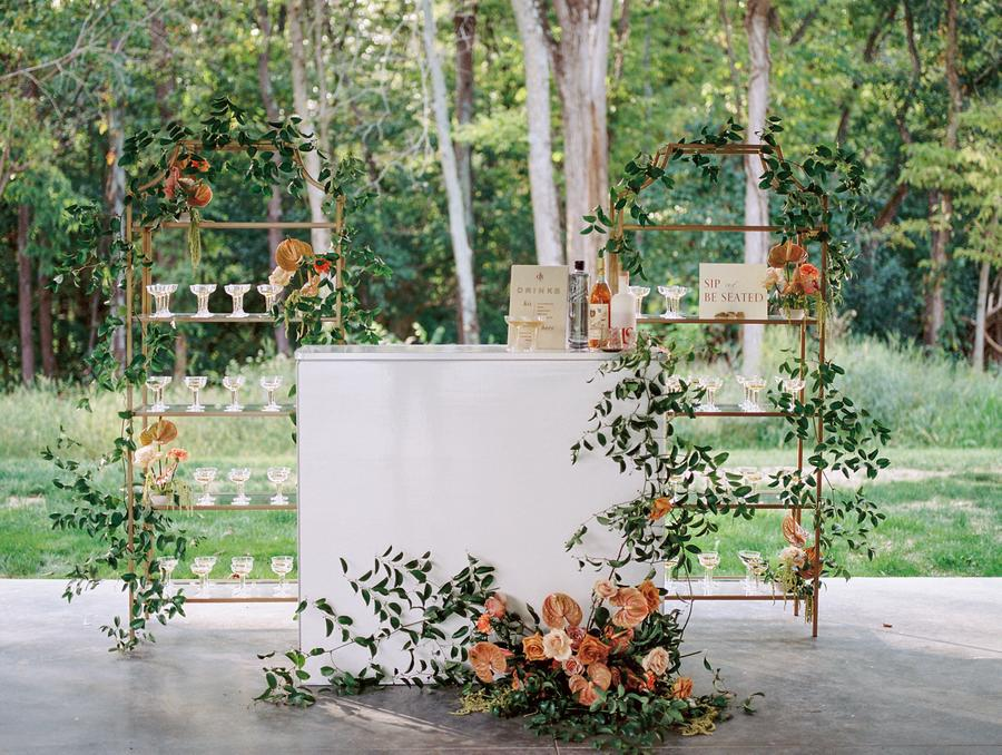 The wedding bar was decorated with the same peachy blooms and greenery all over