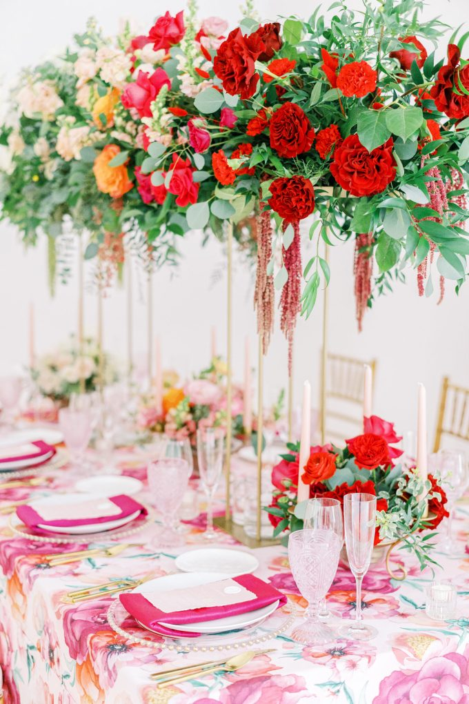 The wedding reception table was done with usual bright and tall wedding centerpieces showing off an ombre effect