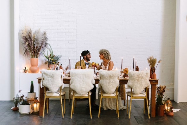 The chairs were covered with faux fur, there were cacti and potted plants