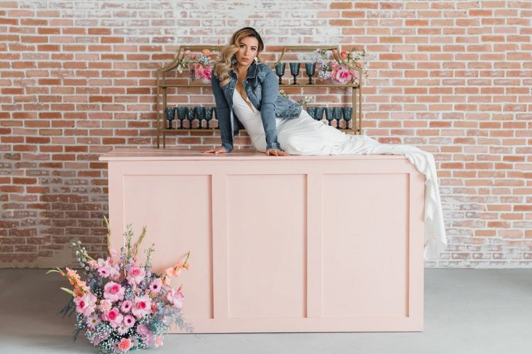 The wedding bar was pink, with bold blooms and gold shelves