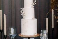 09 The wedding cake was a textural white one, with sugar blooms and looked very refined and beautiful