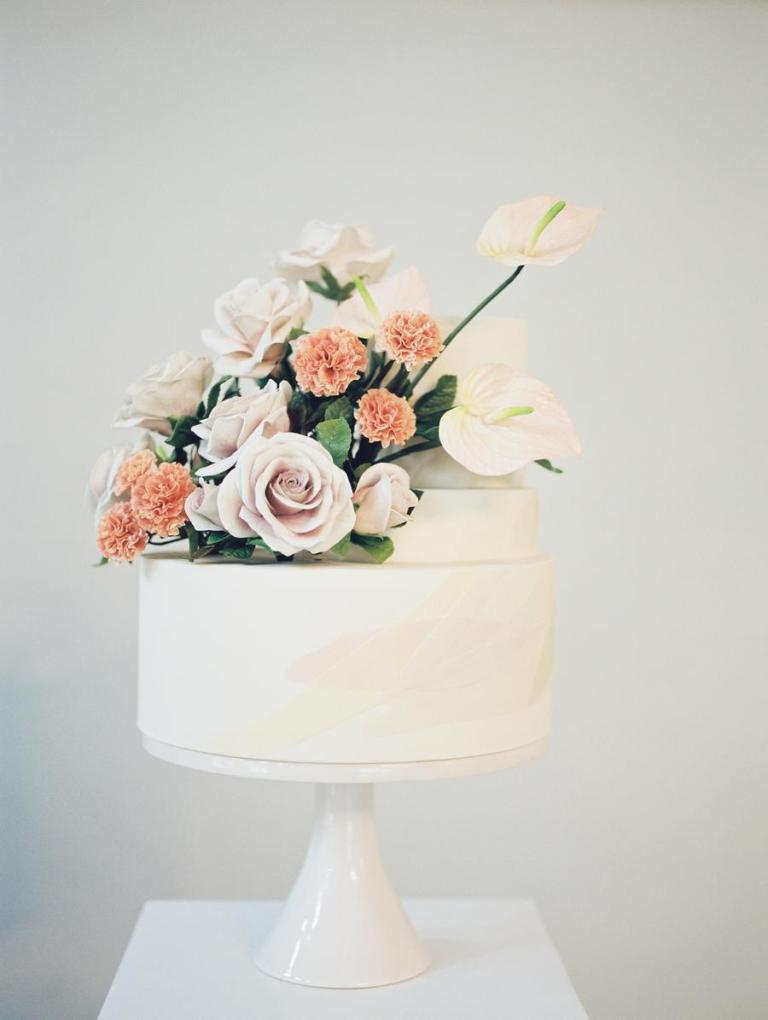 The wedding cake was a white one, with blush and peachy blooms and looked very cool