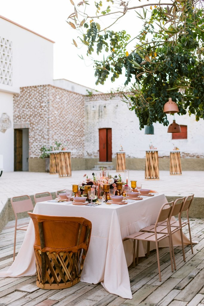 The wedding reception was done outdoors, under the trees with pendant lamps