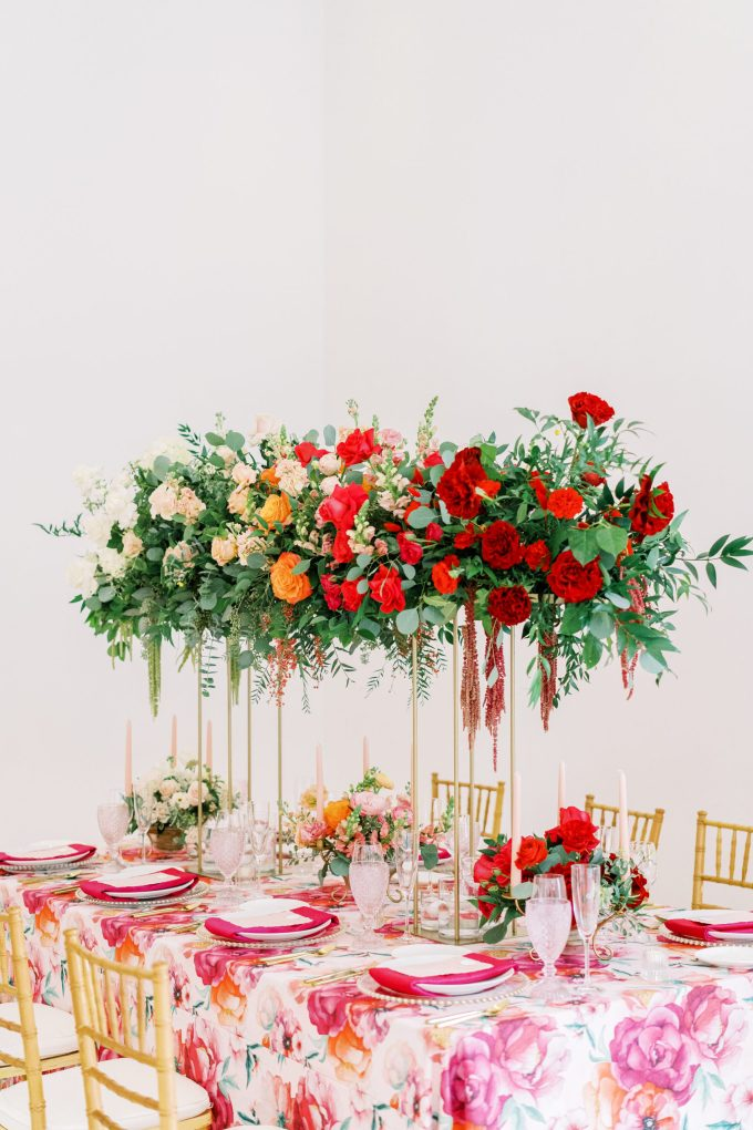 The wedding tablecloth was a bright floral one, with pink napkins and gold cutlery