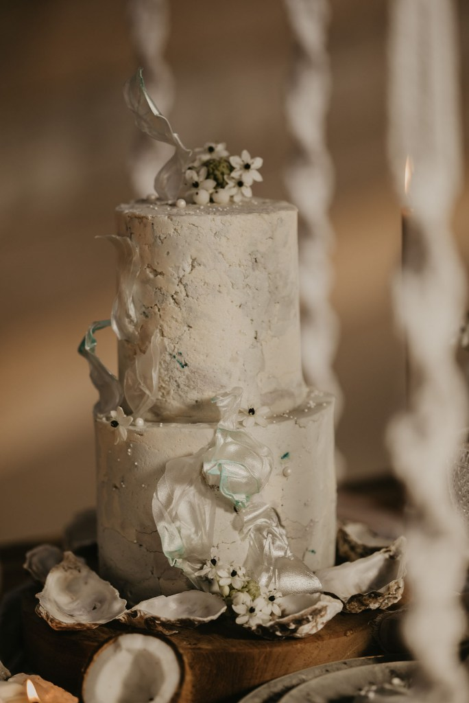 The wedding cake was a textural one, with white blooms, berries and wave-inspired touches
