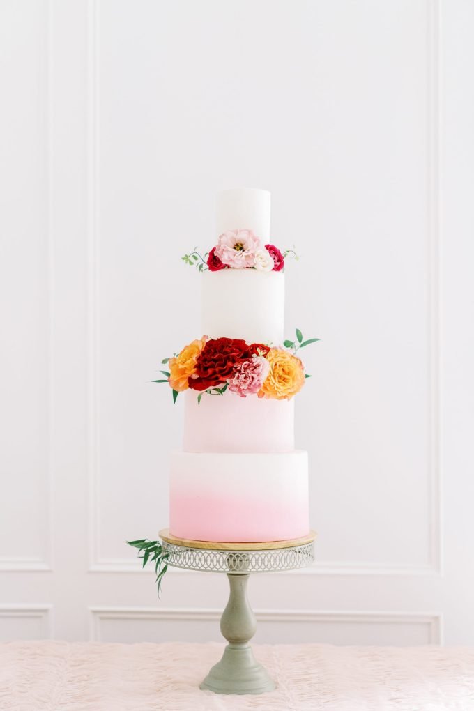 The wedding cake was an ombre pink one with bold blooms and greenery