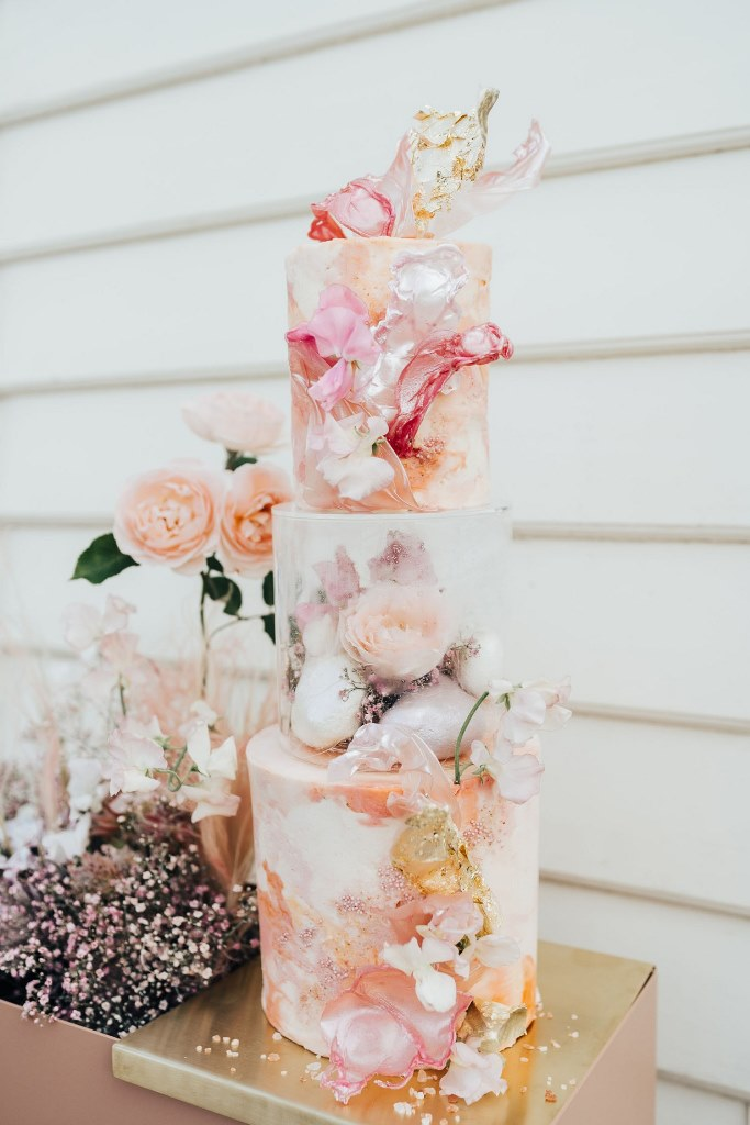 The wedding cake was jaw-dropping, with hand painted and decorated tiers and blooms