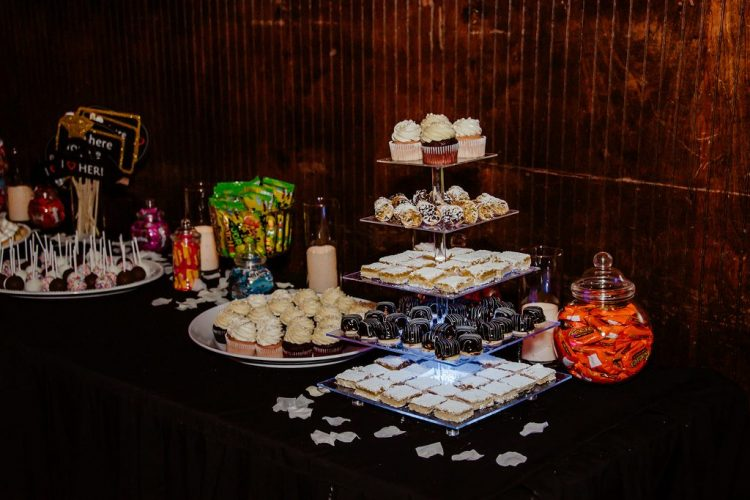 The wedding dessert table was done with pretty clear and sheer stands, bright whimsy candies and sweets