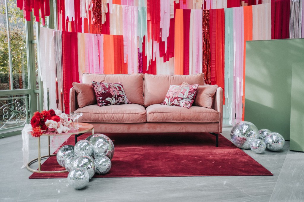 The wedding lounge was matching and was done in pink and red, and just look at that fantastic DIY backdrop